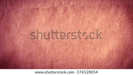 Piece of new crimson thick paper. Paper texture or background - stock photo