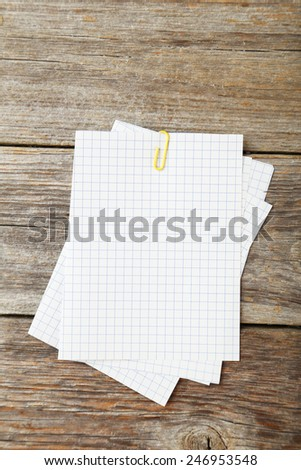 Piece of note paper on grey wooden background - stock photo