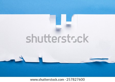 Piece of paper cut in various shapes. - stock photo