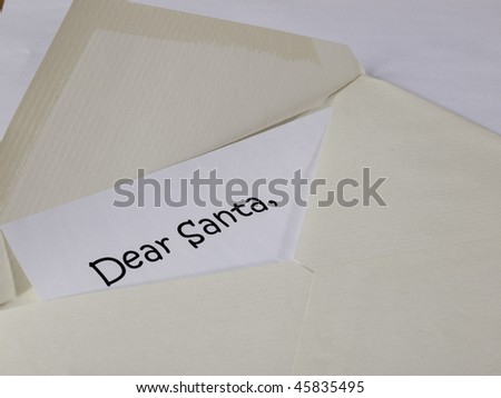 "Piece of paper with ""Dear Santa"" at the top in an envelope"