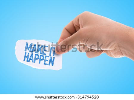Piece of paper with the word Make It Happen with blue background - stock photo