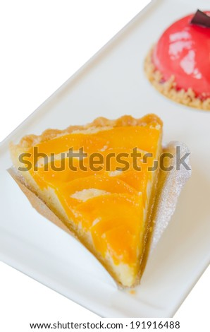 piece of peach tart on dish  , fruit dessert