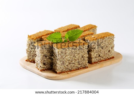 Piece of poppy seed cake on a plate - stock photo