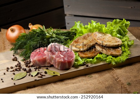Piece of raw meat on a wooden background. - stock photo