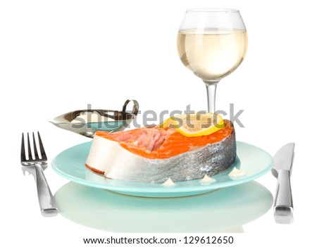 Piece of red fish on plate with with spices and sauce isolated on white