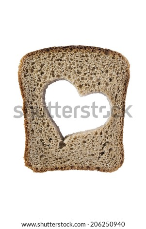Piece of rye bread with clipped heart isolated over white