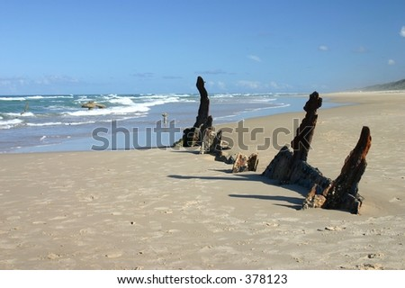 piece of shipwrecked boat in sand - Maheno wreck, Fraser Island, Australia - stock photo