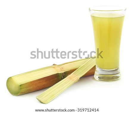 Piece of sugarcane juice in a glass - stock photo