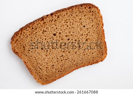 Piece of the black bread on the white