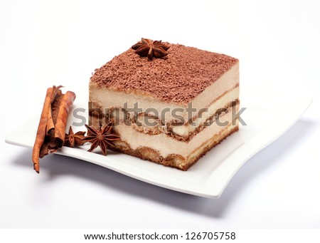 piece of tiramisu on white plate closeup - stock photo