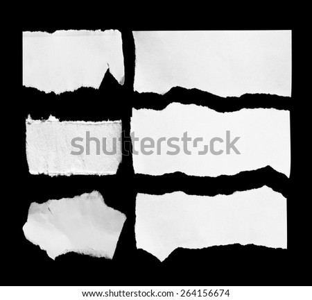 Piece of torn textured paper on black - stock photo