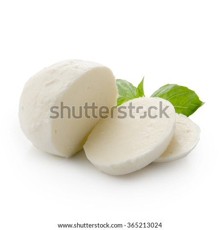 Piece of white mozzarella isolated on white background with clipping path. Decorated with basil. Front view. - stock photo