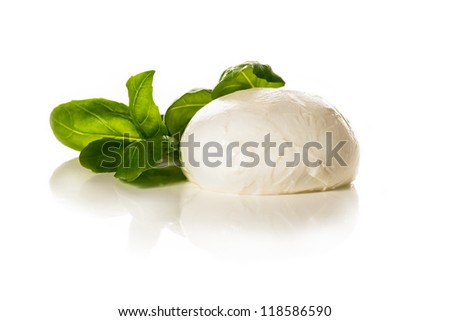Piece of white mozzarella on white background. decorated with basil. - stock photo