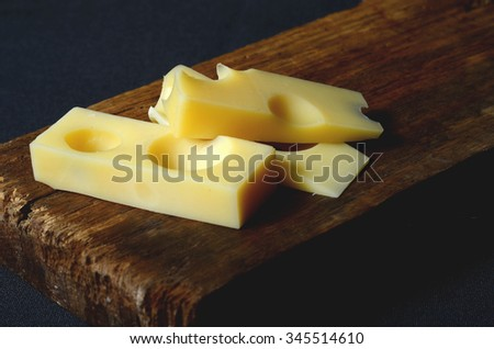 pieces and slices of fresh emmental cheese