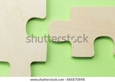 Pieces of a puzzle, close up. Conceptual image of connection, solution and business strategy.