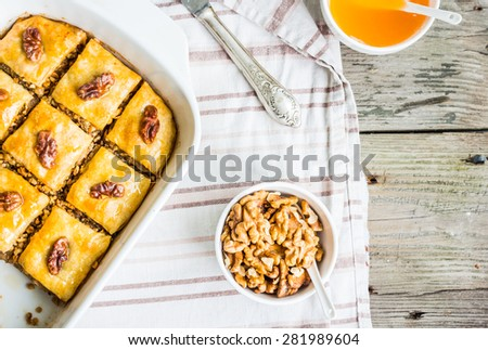 pieces of baklava with honey and nuts on a plate, top view, rustic, traditional Turkish dessert - stock photo