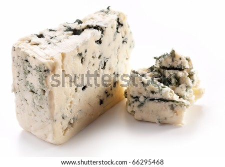 Pieces of blue cheese on a white background. - stock photo