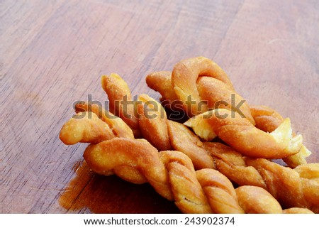 Pieces of braided fried bred on a table - stock photo