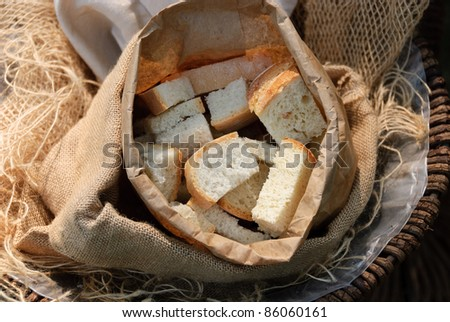 pieces of bread in a paper bag - stock photo