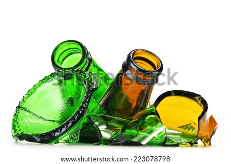 Pieces of broken glass over white background. Recycling. - stock photo