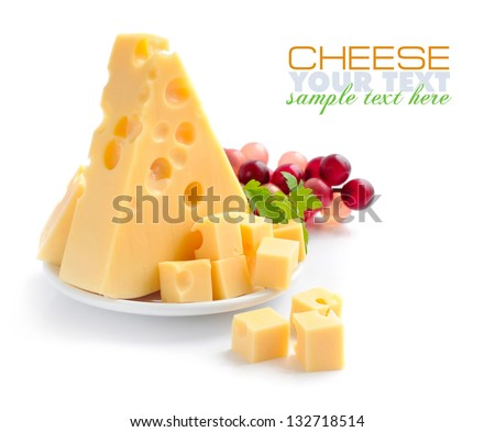 Pieces of cheese on a dish isolated on a white background - stock photo