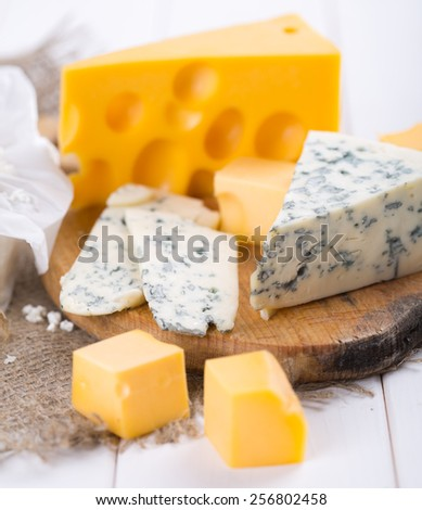 pieces of cheese on a wooden background
