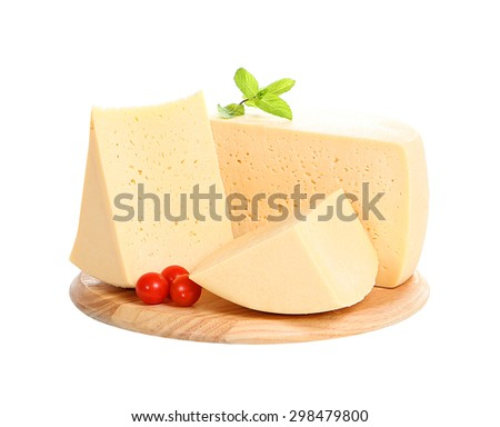 pieces of cheese on a wooden plate isolated on white background - stock photo
