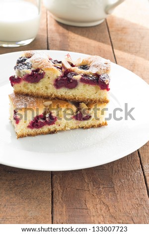 Pieces of cherry cake served on a white plate