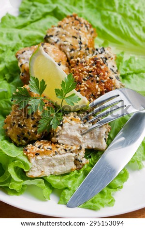pieces of chicken marinated in sesame breading - stock photo