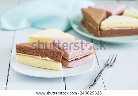 pieces of chiffon cake on plate for snack - stock photo