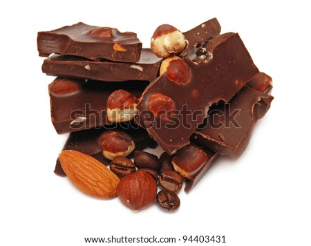 Pieces of chocolate and nuts on white background - stock photo