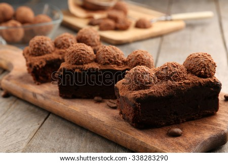 Pieces of chocolate cake on the table, close-up