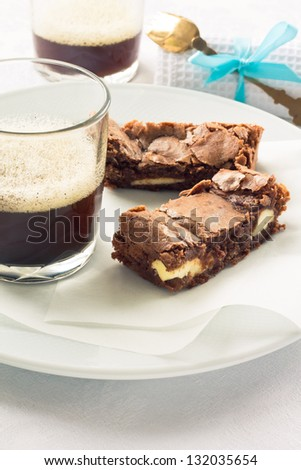 Pieces of chocolate cheesecake brownies on a plate