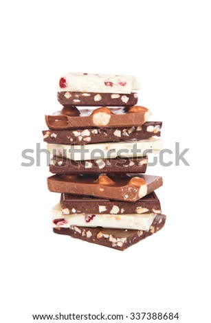 Pieces of chocolate, isolated on a white background - stock photo