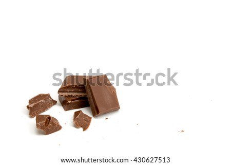 Pieces of chocolate isolated on a white background