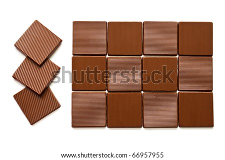 Pieces of chocolate on a white background.