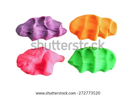 pieces of color plasticine on white background - stock photo