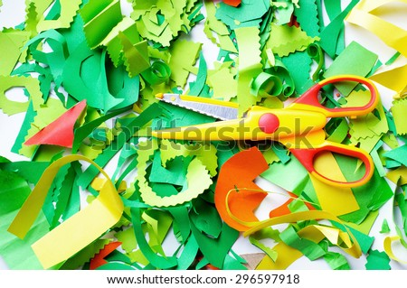 Pieces of colored paper that sliced baby. Cut colored paper and scissors. - stock photo
