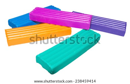 Pieces of colored plasticine isolated on white background - stock photo