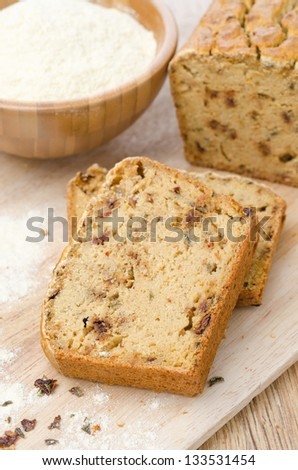 pieces of corn bread with dried paprika on a wooden board vertical - stock photo