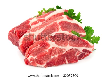 Pieces of crude meat with parsley - stock photo