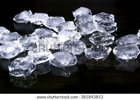 pieces of crushed ice on black background