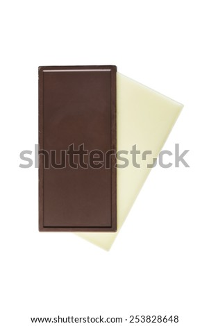Pieces of dark and white chocolate isolated over white - stock photo