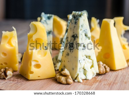 Pieces of emmental and blue cheese - stock photo