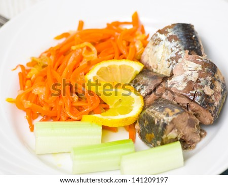 pieces of fish with vegetables