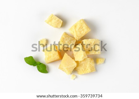 pieces of fresh parmesan cheese on white background - stock photo