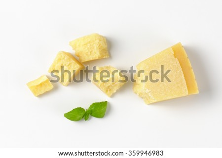 pieces of fresh parmesan cheese on white background