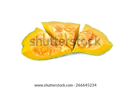 pieces of fresh pumpkin with seeds on white background - stock photo