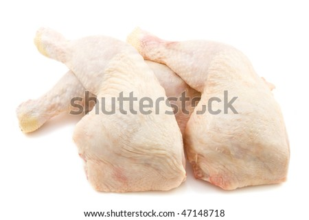 Pieces of fresh raw chicken isolated over white - stock photo