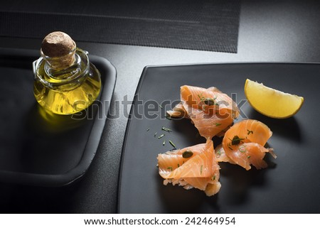 Pieces of fresh smoked salmon served on a plate - stock photo